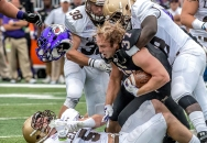 1st PLACE SPORTS ACTION: Austin Bachand, Daily News Record---James Madison University r-senior Deane Cheatham (37) looses his helmet as he gets taken down by the Lehigh defense during their game at JMU's Bridgeforth Stadium on Saturday, September 12, 2015.