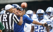 1st PLACE SPORTS FEATURE: Rob Ostermaier, Daily Press---Hampton University coach Connell Maynor argues a call during the third quarter against Norfolk State September 26, 2015 in Norfolk.