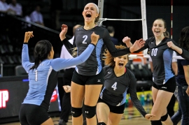 3rd PLACE SPORTS FEATURE: Jonathon Gruenke, Daily Press---From left, Warhill's Jewel Walters, Nicole Mulligan, Alexis Pollard and Chloe Wilmoth celebrate after defeating Hidden Valley during Saturday's 3A state championship volleyball game at VCU's Siegel Center on November 21, 2015.