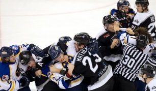 HN SPORTS FEATURE: The' Pham Virginian-Pilot---At the 10:33 mark in the second period, Norfolk Admirals' Gabriel Verpaelst (27) and Reading Royals' Derek Mathers started the fight during their game at the Scope in Norfolk, Va., on Wednesday, Dec. 16, 2015. From that moment on, more players get involved.