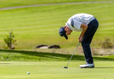 Hidden Valley High School junior Brad Williams watches his putt during the 3A West regional golf tournament at Lakeview Golf Course on Tuesday, October 6, 2015.