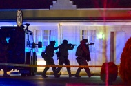 2nd PLACE SPOT NEWS: Bob Martin, Freelance---The Fredericksburg (Va.) Police Department's Special Equipment Tactical Team (SETT) approach a room at the Relax Inn in Fredericksburg, Va. to end a five-hour standoff. A 53-year-old man was taken into custody and transported to a local hospital for a mental evaluation. (April 2, 2015)