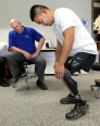 Prosthetist Joe Sullivan watches as Keith Chantree tries out a Triton smart ankle at Powell Orthotics and Prosthetics.