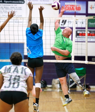James River Head Coach Joe Sullivan works with his volleyball team during practice.