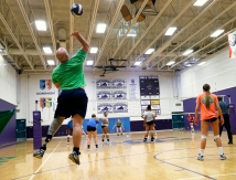 James River Head Coach Joe Sullivan serves while working out with his volleyball team during practice.