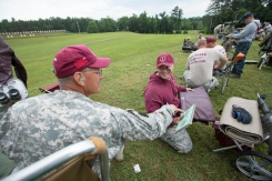 Army CW3 David Kerin gives feedback to Air Force Staff Sgt. Evan Jones, of the National Guard Shooting Team, during the 54th Interservice Rifle Match held at Quantico Va., on Tuesday, June 30, 2015.