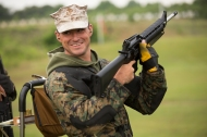 Marine Cpl. Brandon Yaser, of the Paris Island Shooting Team, reacts after one competition at the 54th Interservice Rifle Match held at Quantico Va., on Tuesday, June 30, 2015.