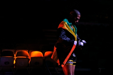 1st PLACE SPORTS PICTURE STORY: Jonathan Gruenke, Daily Press---Stephen Richards waits to enter the ring before his match against Francois Ambang during Friday's SuperFight presented by Glory Sports International at the Hampton Coliseum. GLORY World Series, the popular kickboxing showcase, held a series of 10 bouts, which was broadcasted nationally live on Spike-TV. Different from Mixed Martial Arts (MMA), GLORY kickboxing rules are a mix of several combat disciplines including karate, Muay Thai, tae kwon do and traditional boxing.