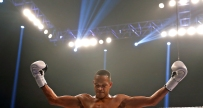 Raymond Daniels celebrates after defeating Jonatan Oliveira during Friday's tournament presented by Glory Sports International at the Hampton Coliseum.