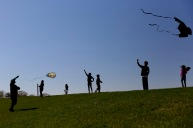 Visitors at Mount Trashmore Park in Virginia Beach, Va., enjoy the sunshine and warmer temperatures brought to the Hampton Roads area on Tuesday, March 29, 2016.