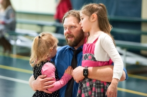 Eric Comer, of Rockingham County, gets teary-eyed as he slow dances with his daughters, Stella (left), 4, and Maggie, 6, during the last songs played for the evening.