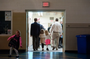 Fathers leave with their daughters in tow at the end of the dance.