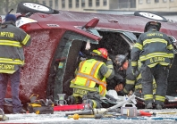 Hampton firefighters and police extract a person from a vehicle after it overturned near the intersection of Pembroke and LaSalle Avenue Saturday afternoon on January 23, 2016.