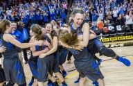 Spotswood sophomore guard Meredith Vetter jumps into the arms of her twin sister, sophomore forward Brooke Vetter as the team celebrates after winning their VHSL 3A state championship game against Magna Vista in Richmond, Va., Saturday, March 12, 2016.