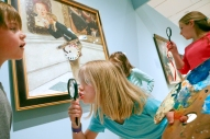 "Maverick Johnston, 7, Naomi Lankford, 6, and Lydia Lankford, 10, reenact Norman Rockwell's painting titled ""Art Critic,"" at the Taubman Museum on Wednesday. American Chronicles: The Art of Norman Rockwell is on exhibit at the museum until June 12. The homeschoolers from Botetourt County attend the museums children program and recreated scenes from the exhibit and even used props provided by the museum."