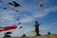 "Wearing his superman attire, Brody Allen, 8, of Virginia Beach, Va., flies a kite during the 12th Annual Atlantic Coast Kite Festival along the Virginia Beach Oceanfront in Virginia Beach, Va., on Saturday, April 30, 2016. "" If kites were going to be flying in the air I knew my cape would too, said Allen of his outfit choice."