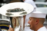 Jonathan Elcewicz from Auburn, Maine, plays the tuba with the Navy Fleet forces Band on the Roanoke City Market during Navy Week in the Roanoke/Lynchburg metro areas.