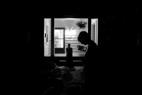 Frankie Garner, center, sits on her porch as Karen Garner stands in front of their of house Tuesday evening April 26, 2016. Jim Garner died from Alzheimer's April 2, 2016.