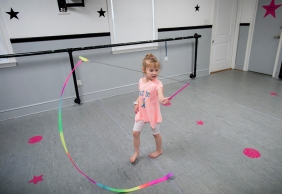 Kaleigh Laughon dances with a ribbon during Forest Dance Academy's Superhero Dance Camp.