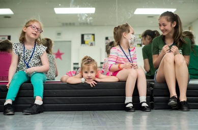 Gracie Barber, Kaleigh Laughon, Emily Woodall and volunteer Zoie Younce take a break during the Forest Dance Academy's Superhero Dance Camp.