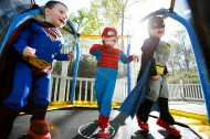 (From left) Finnegan, Brandon and James Brehony bounce on a mini trampoline on their back porch on Sunday April 17, 2016. The boys are triplets to first time parents Kate Bredimus and Matt Brehony. On the weekends the parents let the kids dress as their favorite super hero, and each boy has his specific favorite character.