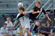 York's Max Poelker heads the ball away from Tabb's Andrew Lenfant, right, during Friday's Conference 27 final at Bailey Field on May 27, 2016.