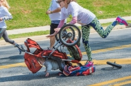 The front wheel came off of Susan Malburg's stroller and tipped over but the baby and Malburg were not hurt as both were quickly cared for by other runners in the IRON 5 K Race on Sunday.