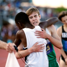 Maggie Walker's Ryan Buscaglia, who finished fourth in the mile at the Southern Track Classic last week, receives a hug from Douglas Freeman's Waleed Suliman, who won the race at the Southern Track Classic track and field meet on Friday May 13, 2016. Buscaglia's father died suddenly earlier that week and he received an outpouring of support from the local track community. His father, Bruce, has been planning on going to the doctor for bruising on May 9, was diagnosed with acute leukemia, which he didn't know he had and passed away May 10.