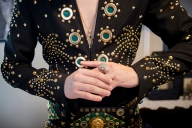Taylor Rodriguez puts on his replica rings to the ones Elvis Presley wore while suiting up for a performance.