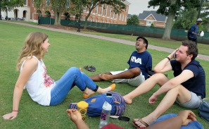 Christopher Newport student James Dennehy sits with friends on the great lawn after classes Wednesday August 31, 2016. Dennehy is not shy when people have questions and often jokes about the fact he has no arms.