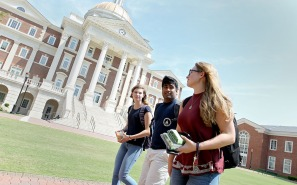 Christopher Newport student James Dennehy walks to class with Meghan Casey and Kelly Duggan Tuesday afternoon August 30, 2016. James has taken an interest in politics and did an internship at the Whitehouse over the summer.