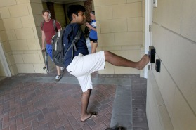 Christopher Newport student James Dennehy swipes the keycard for his dorm after classes. With small exceptions, everything a normal person does with their hands he can accomplish with his feet.
