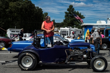Danny Mitchell stands in his dragster while in the staging area before racing at the New London Dragstrip on Sunday September 11, 2016 in Forest, Va.