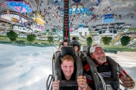 Isaiah Burroughs, 9, of Bridgewater, and his grandfather Junior Knight, of Elkton, ride the fireball ride at the Rockingham County Fair in Harrisonburg, Va., on Friday, August 19, 2016.