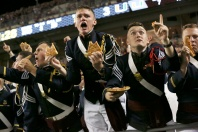 The Virginia Tech Corps of Cadets react to the game as they eat pizza during the first half of the game against Miami University in Blacksburg, Va. Thursday, October 20 2016.