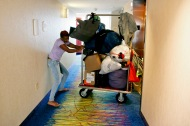 Diamond Gilmore moves her and her 3-year old son's belongings out of her hotel room and into Julissa and Phillip's room on Wednesday, November 2, 2016. Although the apartment's management company originally helped displaced families with hotel expenses, the time had run out and Diamond needed a place to stay.