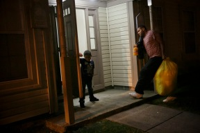 "Julian Barada, 4, holds the door for his dad as they move what is left of their belongings into their new home late on Thursday, November 3, 2016. ""I've worked so hard to provide the things I have for my family, I just want my couch,"" said Barada. The family had recently saved money to buy a new couch that's currently still sitting in their old apartment, along with all of their other belongings that they've been barred from returning to get."
