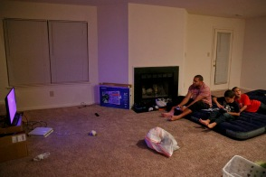 "After making a trip to Walmart for air beds, pillows and a small television, Phillip, Julissa, Julian and Phillip Jr., spend their first night in their new apartment. ""This was a bad idea,"" reflected Sosa after attempting to unpack a small bag of clothing and realizing that she didn't have any clothes hangers. ""I just feel so unprepared,"" she said."
