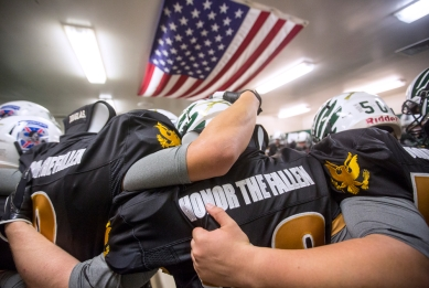 (20161104) - (Broadway) Broadway High School football players embrace each other in the locker room before the start of their annual Soldier Tribute Game.
