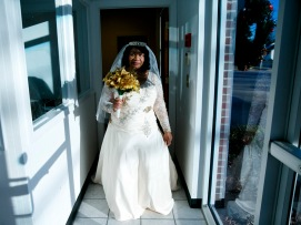 Bride Elizabeth carefully walks around the corner so as to not reveal her dress to groom, Arthur Lawrence Sr., prior to the start of their wedding at New Weeping Mary Missionary Baptist Church in Chesapeake, Va., on Saturday, December 10, 2016. The couple has been married for 50 years but due to LawrenceÕs military career, they were unable to have a planned wedding and married in a quick ceremony in 1966. Lawrence's daughter, Elizabeth Coleman, planned a wedding for her parents.
