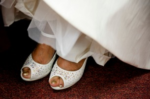 The toes of Elizabeth Lawrence peek out from her shoes underneath her wedding dress at New Weeping Mary Missionary Baptist Church in Chesapeake, Va., on Saturday, December 10, 2016.