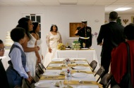 The family of Elizabeth and Arthur Lawrence Sr., watches on as they greet their guests before sitting down at their wedding reception at New Weeping Mary Missionary Baptist Church in Chesapeake, Va., on Saturday, December 10, 2016.