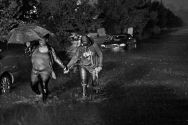 People walk through a flooded road near City Line Apartments near Lassiter Drive Saturday evening October 8, 2016 as heavy rain from Hurricane Matthew hits the area.