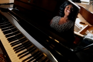 "Laurice Lanier-Trowell is reflected in a piano Wednesday afternoon November 30, 2016. Lanier-Trowell, a graduate of The Juilliard School, has performed on Broadway and in 2014 stepped away from the stage to take care of her mother. Lanier-Trowell will serve as the lead singer in ""Collaborating in a Room Full of Art,"" which will feature multiple local dance companies December 10 at the American Theatre in Hampton."