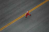 A lone santa runs along 19th street in Virginia Beach, Va., during the Surf-n-Santa 5 Miler on Saturday, December 17, 2016. Over 5,700 runners dresses as santa ran on Saturday in an attempt to break the Guinness world record for the largest santa run in the world. Participants had to run the race in a five-piece santa suit that they received at registration to be counted in the final tally of participants.