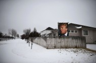 2nd Place Election: Matt McClain, Washington Post--A photograph of presidential candidate, Donald Trump is seen in a residential neighborhood on Tuesday February 02, 2016 in West Des Moines, IA.
