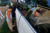 2nd Place General News: Jonathon Gruenke, Daily Press--Jessica Leitch, right, begins to cry as Benjamin Leitch, left, and Gracelyn Leitch enter the family's van Sunday morning July 17, 2016 to move to Missouri from Smithfield. Jessica is leaving behind her husband John Leitch in hopes of finding better special education for Benjamin.