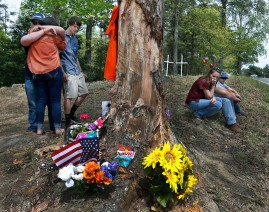 "3rd Place General News: P. Kevin Morley, Richmond Times-Dispatch--Classmates of Dylan Ballard, 17, gather at a memorial site at the scene where Ballard and Elliott Hinton, 22, died Saturday night when the truck they were in drove off the 6000 block of Cold Harbor Road and into this tree. At left, Ballard's football teammate Nathan Johnson (facing) embraces Jenna Head and Cade Prior looks at the items left at the site. Said Johnson of Ballard, ""That's my brother. He was my best friend."" At right, Bailey Campbell (left) and Jacob Bragg were among many close friends of Ballard's who came to the site after school let out Monday, April 25, 2016."