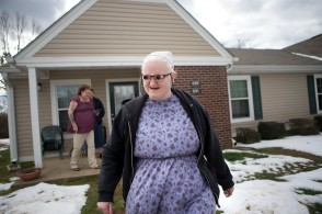 "Tonya Davison, 36, sets out on her own with her new telescopic glasses to retrieve the mail at her mother's apartment in Keysville, Va. on Friday, Jan. 29, 2016. ""It has opened up a whole new world,"" Davison said. Prior to receiving her new glasses, Davison's mother, Brenda Williams, usually escorted her whenever she walked anywhere so she didn't bump into anything or trip over uneven pavement. Now she can walk on her own comfortably."