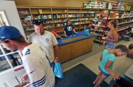 Customers bustle in and out of the Daley & Son Grocery store of Tangier Island on Friday, Aug. 12, 2016. The island has one grocery store and if residents want a specialty item they must place an order to be brought in by ferry.